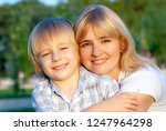 happy mother with son in the... | Shutterstock . vector #1247964298