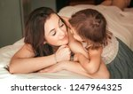 happy woman with her daughter... | Shutterstock . vector #1247964325