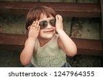 happy little girl in sunglasses | Shutterstock . vector #1247964355