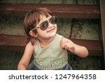 happy little girl in sunglasses | Shutterstock . vector #1247964358