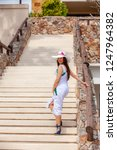 beautiful woman in white hat... | Shutterstock . vector #1247964382