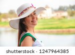beautiful woman in white hat... | Shutterstock . vector #1247964385