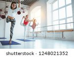 group of woman practice... | Shutterstock . vector #1248021352