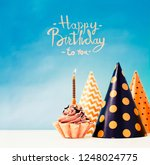 birthday cake with candle in... | Shutterstock . vector #1248024775