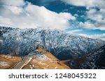 stepantsminda  georgia. famous... | Shutterstock . vector #1248045322