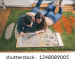 top view of young couple laying ... | Shutterstock . vector #1248089005