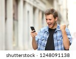 excited man checking news on... | Shutterstock . vector #1248091138