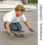 boy riding skate board while... | Shutterstock . vector #124814062
