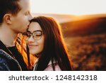 handsome young man keeping eyes ... | Shutterstock . vector #1248142318