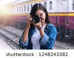 Photographer Young Woman Takin...