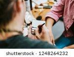 makeup artist holding a makeup... | Shutterstock . vector #1248264232
