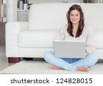happy woman with laptop on... | Shutterstock . vector #124828015