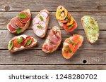 brushetta or traditional... | Shutterstock . vector #1248280702