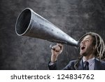 Young Businessman Yelling...