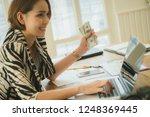 online payment man and woman ... | Shutterstock . vector #1248369445
