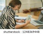 online payment man and woman ... | Shutterstock . vector #1248369448