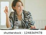 asian business woman working in ... | Shutterstock . vector #1248369478