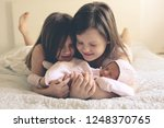 funny children sisters are... | Shutterstock . vector #1248370765
