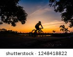 shadow of the cyclists at... | Shutterstock . vector #1248418822