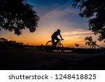 shadow of the cyclists at... | Shutterstock . vector #1248418825