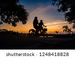 shadow of the cyclists at... | Shutterstock . vector #1248418828