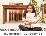indian little girl sitting with ...   Shutterstock . vector #1248439495