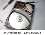 computer hard drive disassembly. | Shutterstock . vector #1248505015