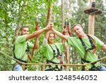 proud team in the high ropes...   Shutterstock . vector #1248546052