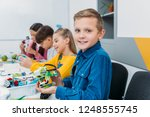 boy showing colorful robot... | Shutterstock . vector #1248555745