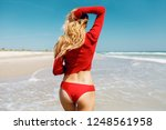 view from back. blond graceful... | Shutterstock . vector #1248561958