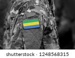 flag of gabon on soldiers arm....   Shutterstock . vector #1248568315