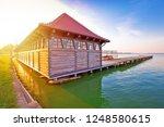 sunrise at palic lake wooden... | Shutterstock . vector #1248580615