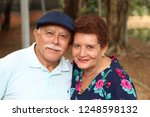 tender older ethnic couple... | Shutterstock . vector #1248598132