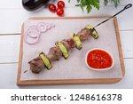 grilled meat on metal skewer...   Shutterstock . vector #1248616378