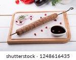 kebab meat grilled on a skewer...   Shutterstock . vector #1248616435