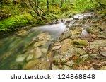 flowing water in mountain river ... | Shutterstock . vector #124868848