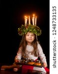 little caucasian girl in saint... | Shutterstock . vector #1248733135