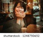 asian woman drinking coffee in  ...   Shutterstock . vector #1248750652