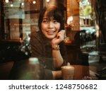 asian woman drinking coffee in  ... | Shutterstock . vector #1248750682