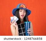 happy woman in black dress on... | Shutterstock . vector #1248766858