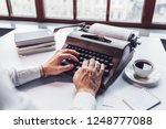 young writer typing on a retro... | Shutterstock . vector #1248777088