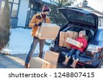 fsther and daughter moving to... | Shutterstock . vector #1248807415