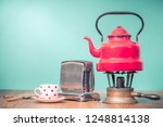 retro classic red kettle on... | Shutterstock . vector #1248814138