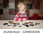 cute preschooler boy playing... | Shutterstock . vector #1248836338