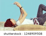 urban girl with a smartphone... | Shutterstock . vector #1248909508