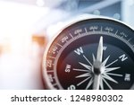 holding compass on tree... | Shutterstock . vector #1248980302