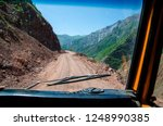 a road through a very broken... | Shutterstock . vector #1248990385