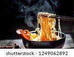 hand uses chopsticks to pickup... | Shutterstock . vector #1249062892