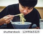 asian men eat ramen with... | Shutterstock . vector #1249065325