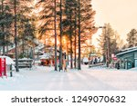 sunset in santa claus village... | Shutterstock . vector #1249070632
